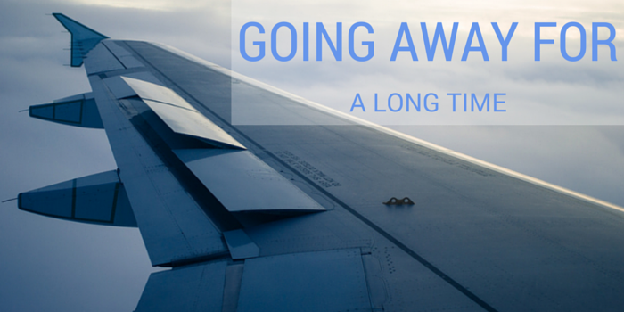 going away for a long time blog header image with plane wing view