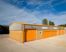 outdoor view of orange industrial storage units
