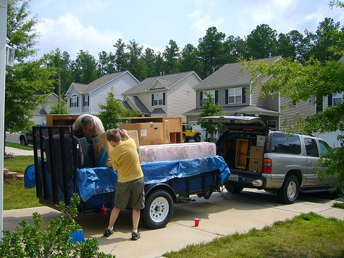 packing car and trailer with boxes for storage